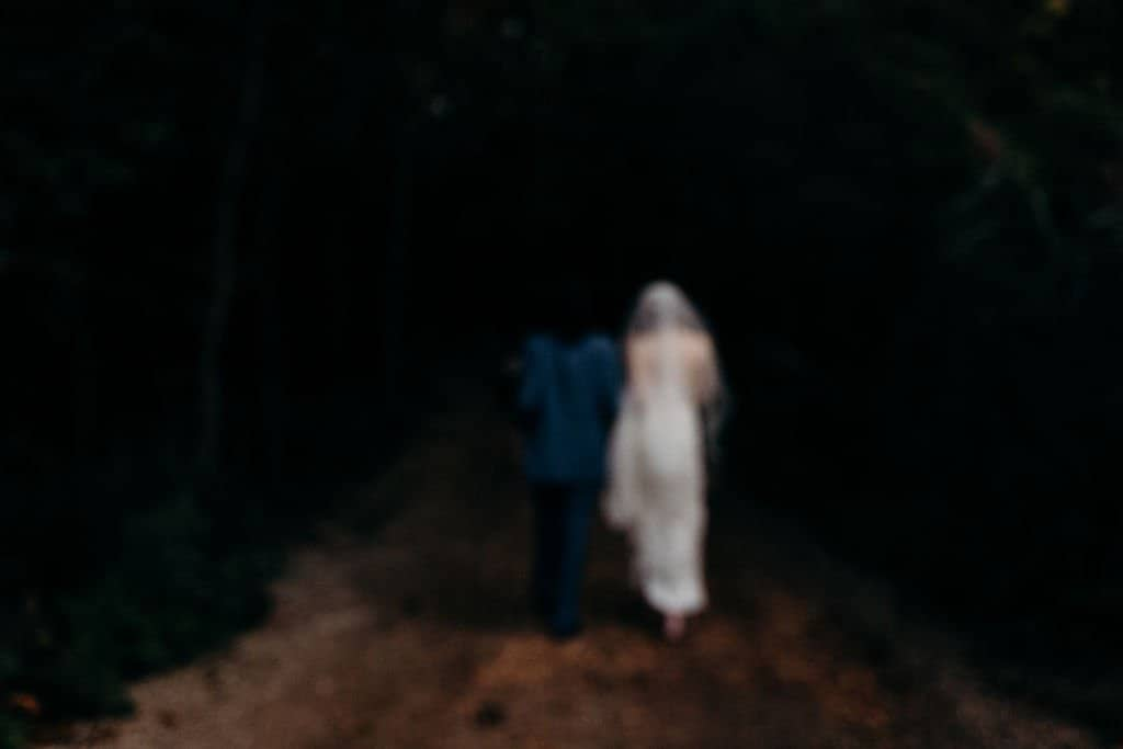 bride and groom walking away at Sapphire Creek Winery