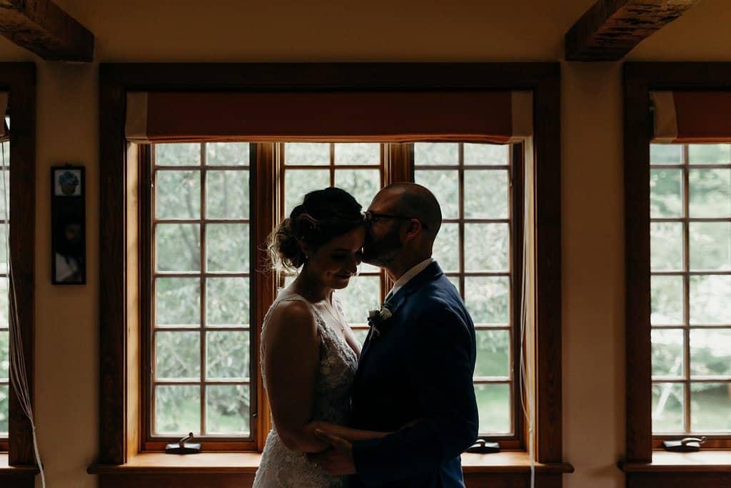 husband kisses forehead of wife