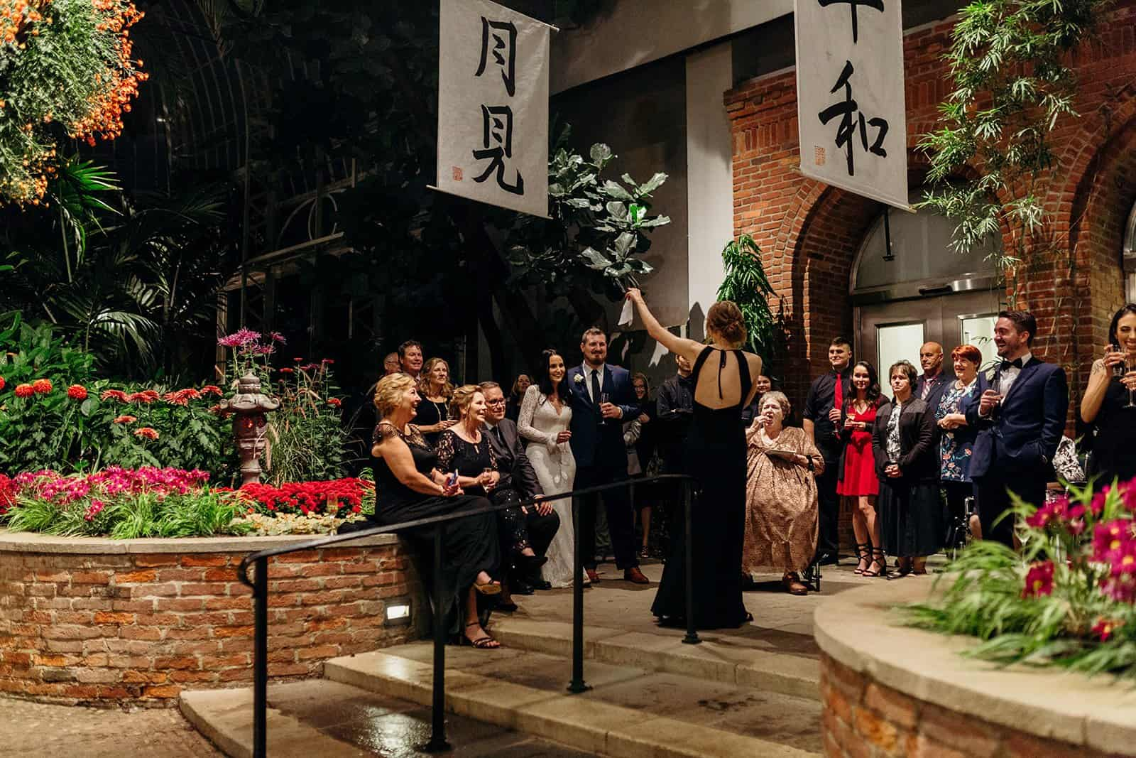 woman gives speech to the newly wed couple