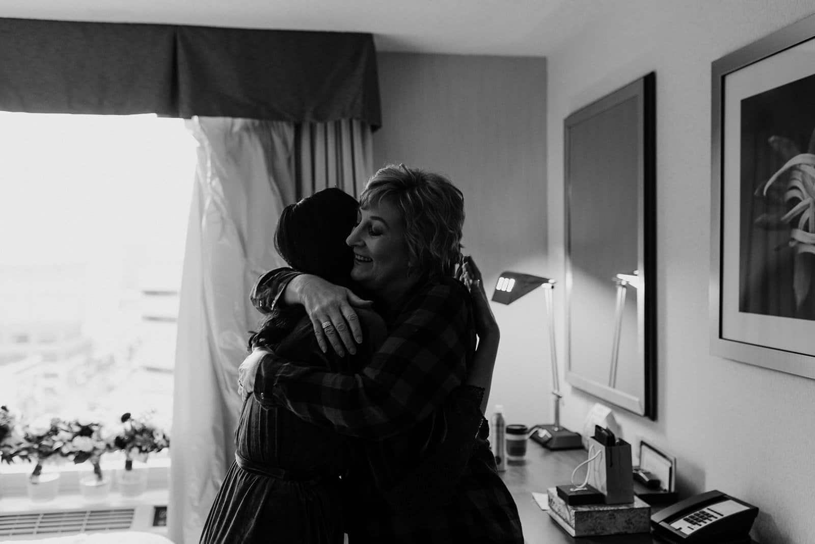 Two people hug