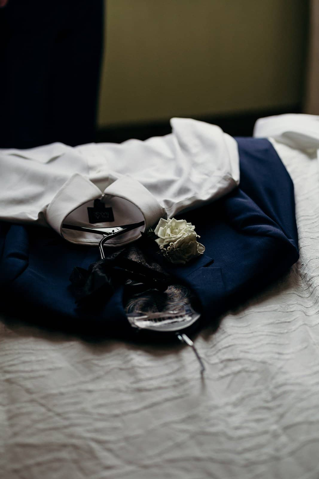 White shirt and jacket on bed