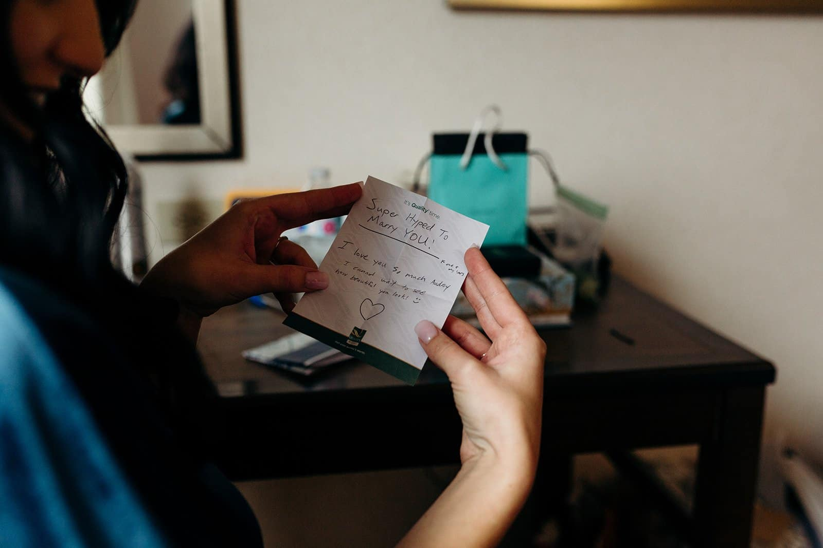 Bride reading hand written note from future husband