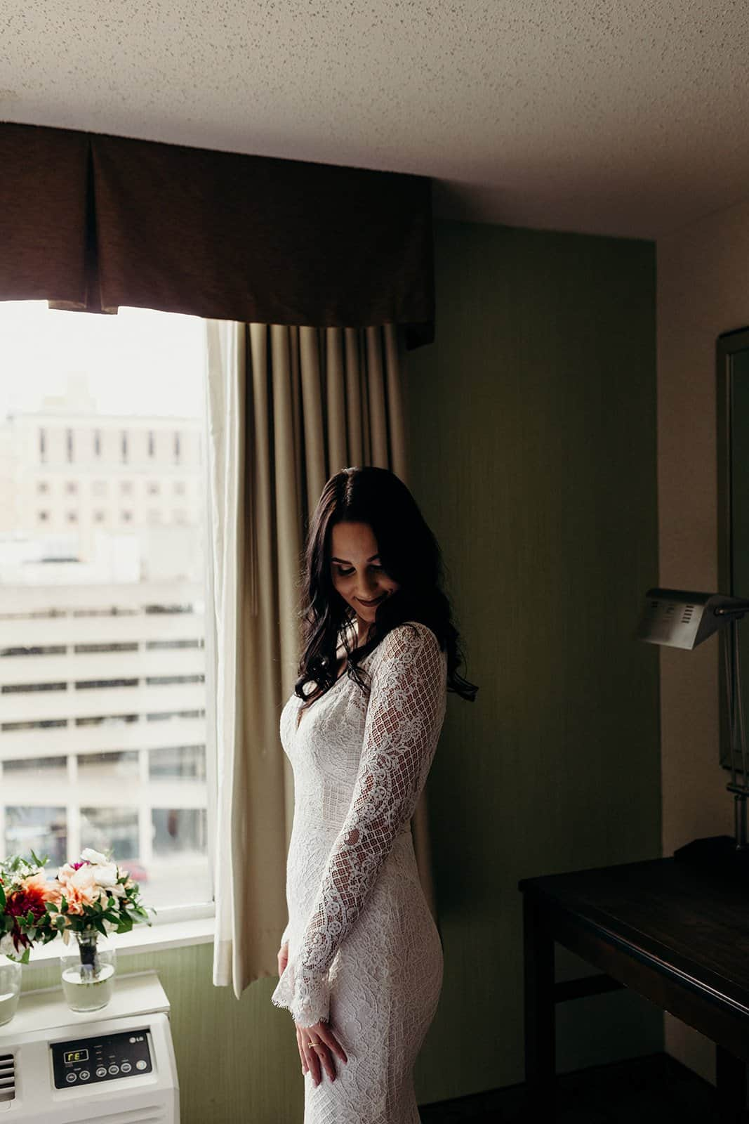 Bride poses after getting ready