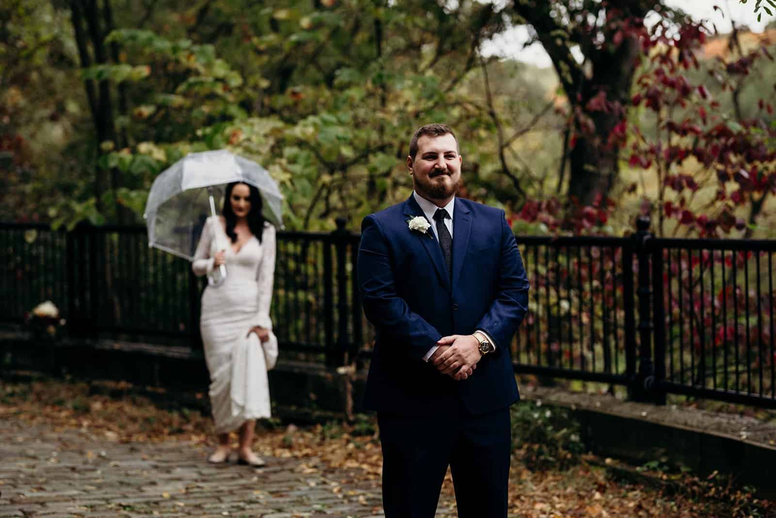Grooms stands and waits while Bride prepares for first look