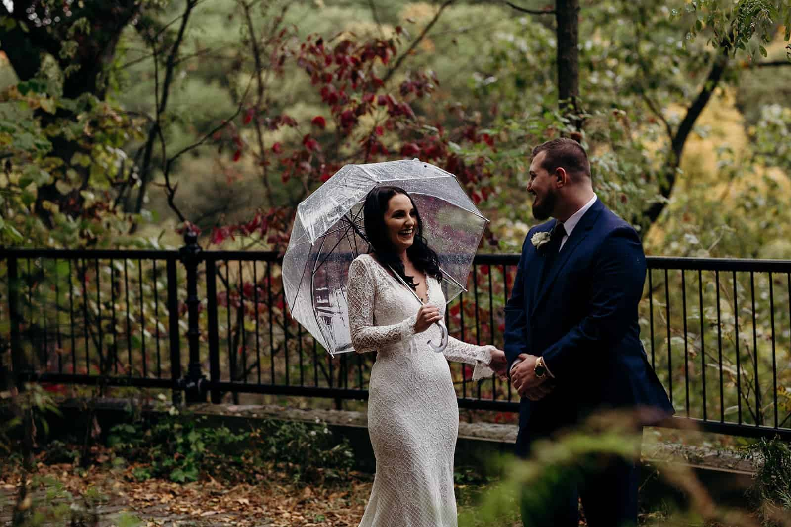 Husband looks in awe at his new wife during first look