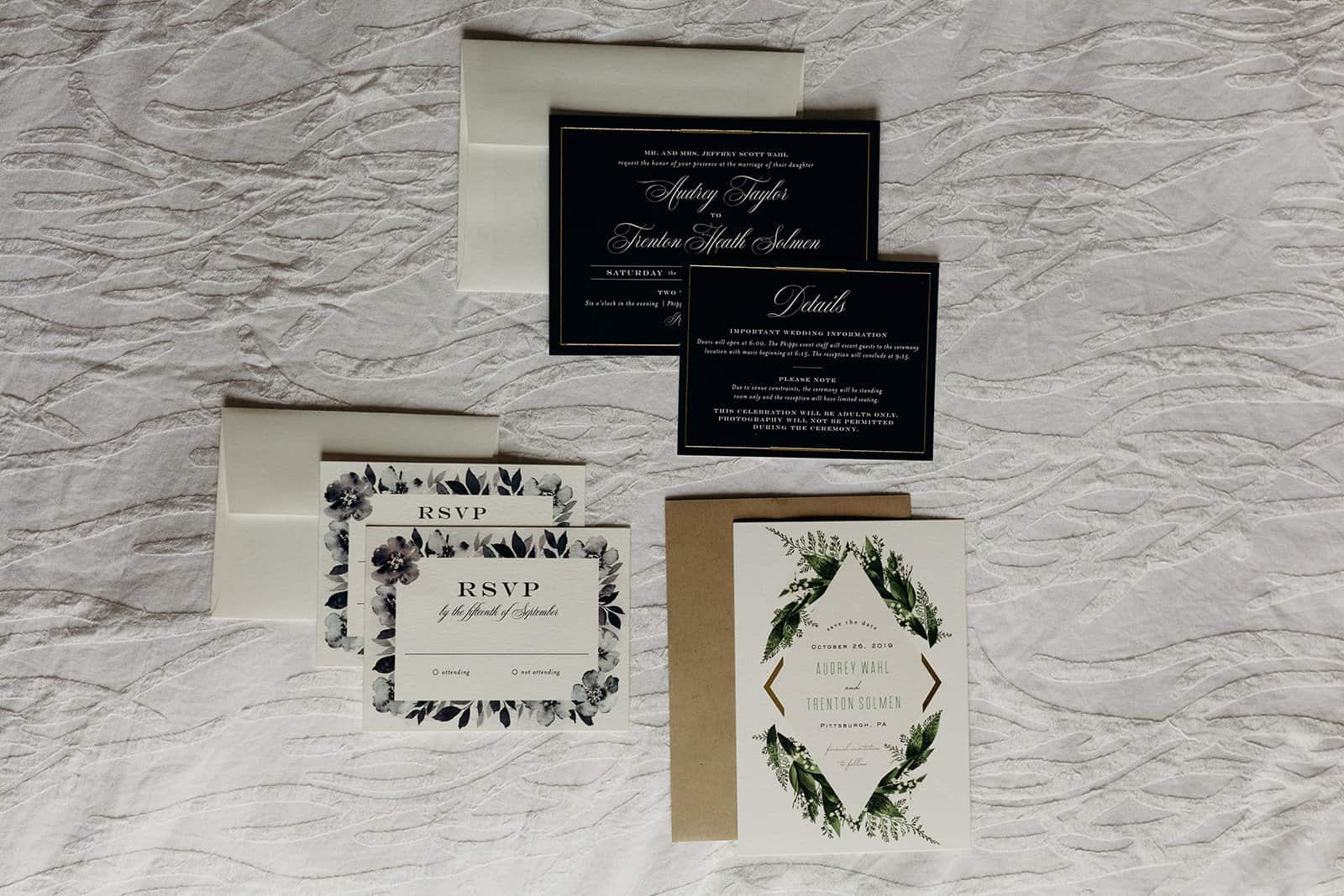 overhead shot of invitation suite on bed