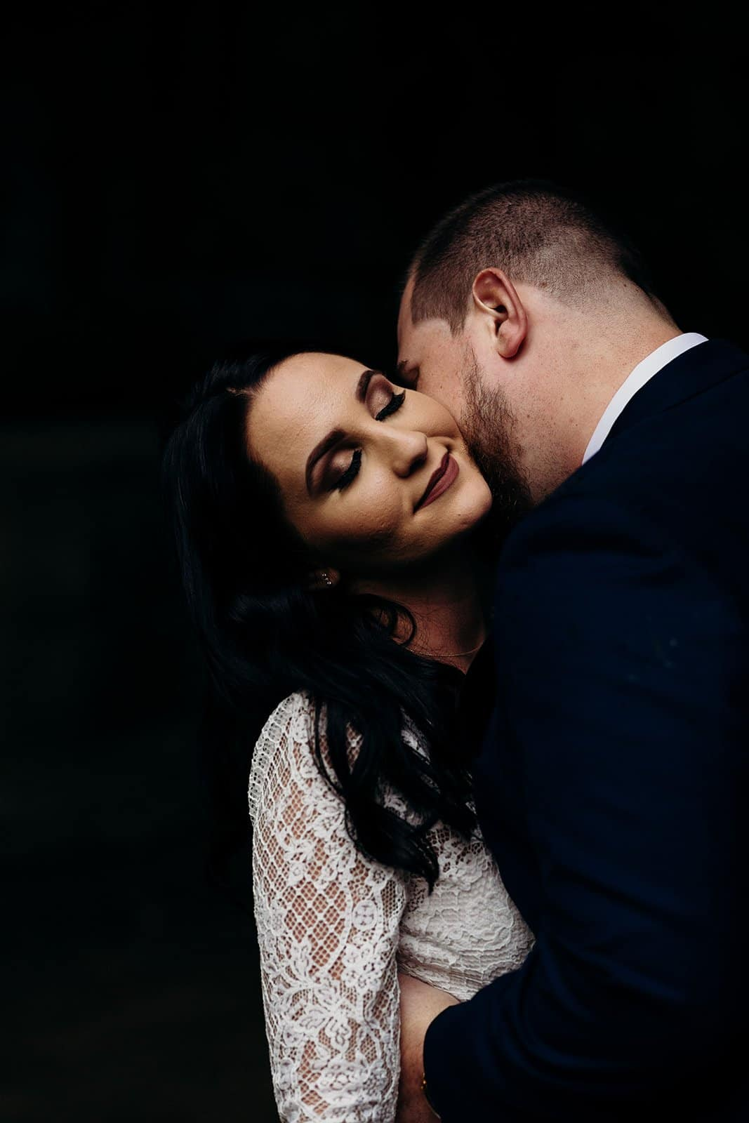 husband kisses the neck of his wife
