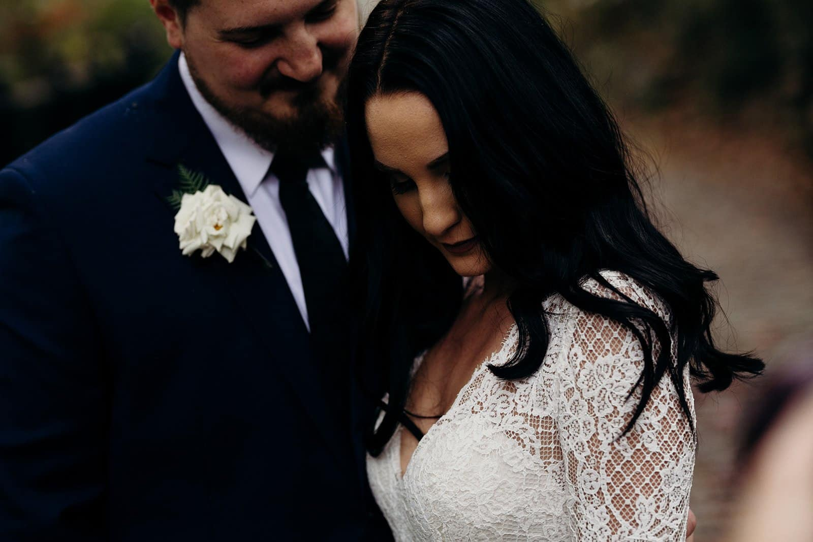 groom looks longingly at his bride