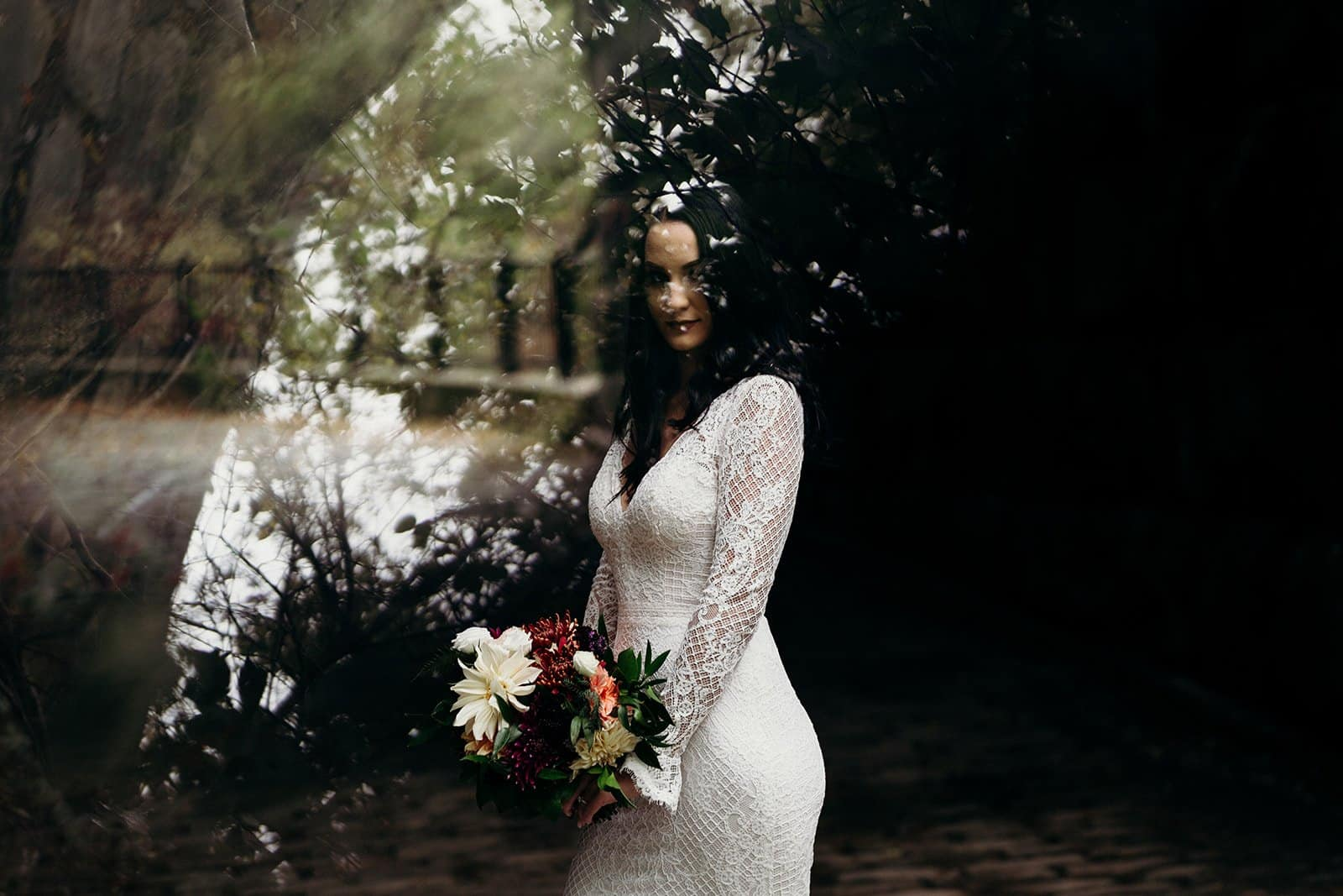 Bride poses while holding bouquet