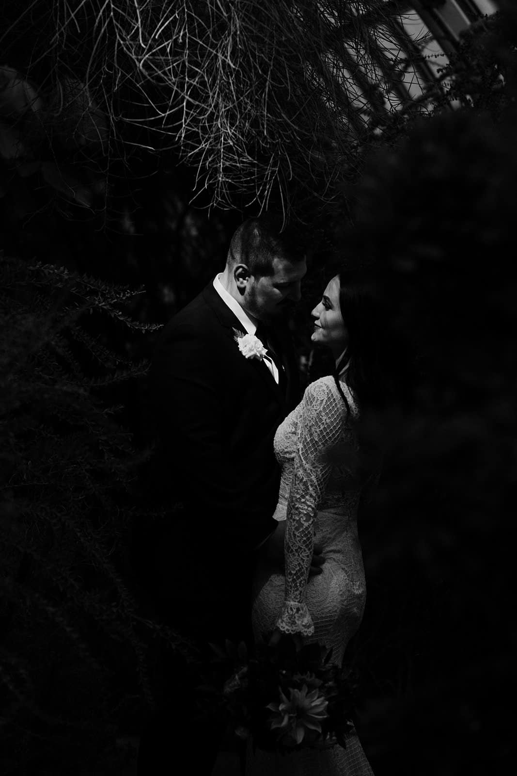 dark and moody photograph of husband and wife