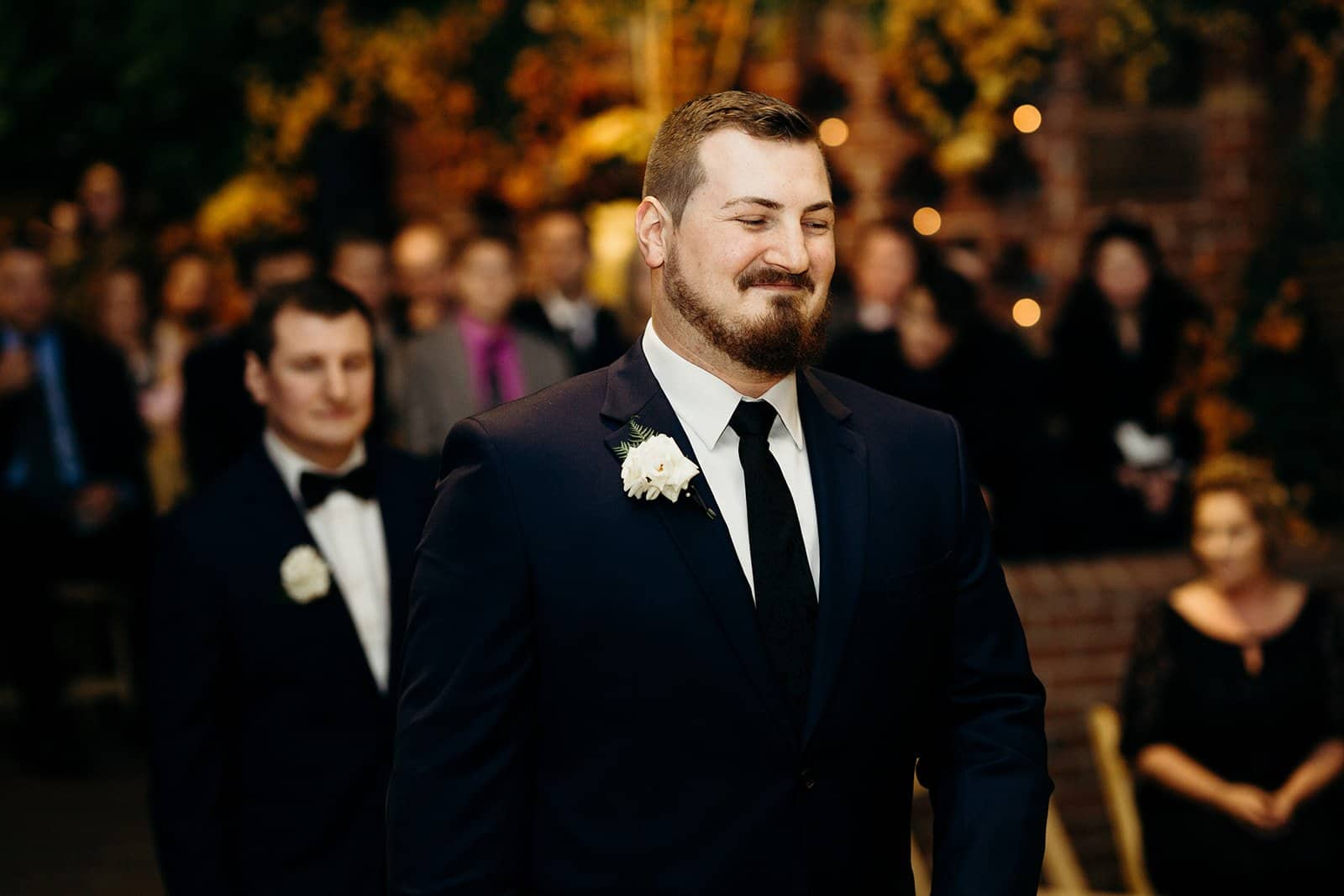 groom smiling and walking