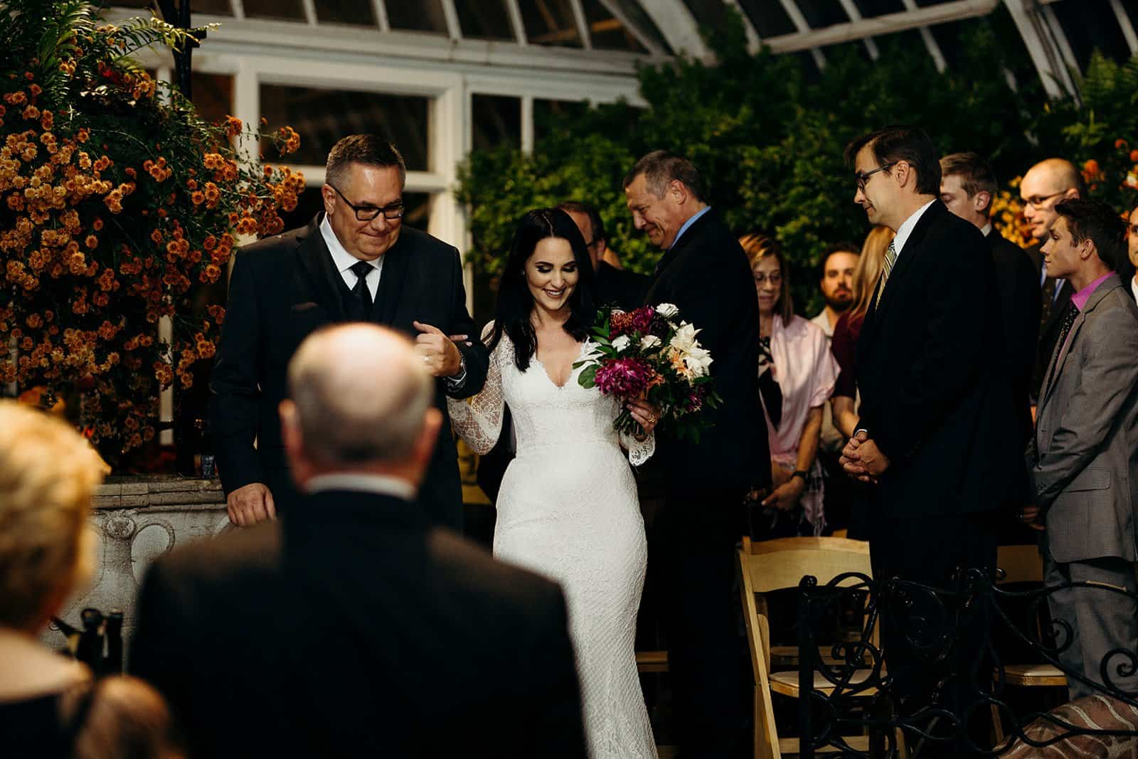 father escorting bride during wedding
