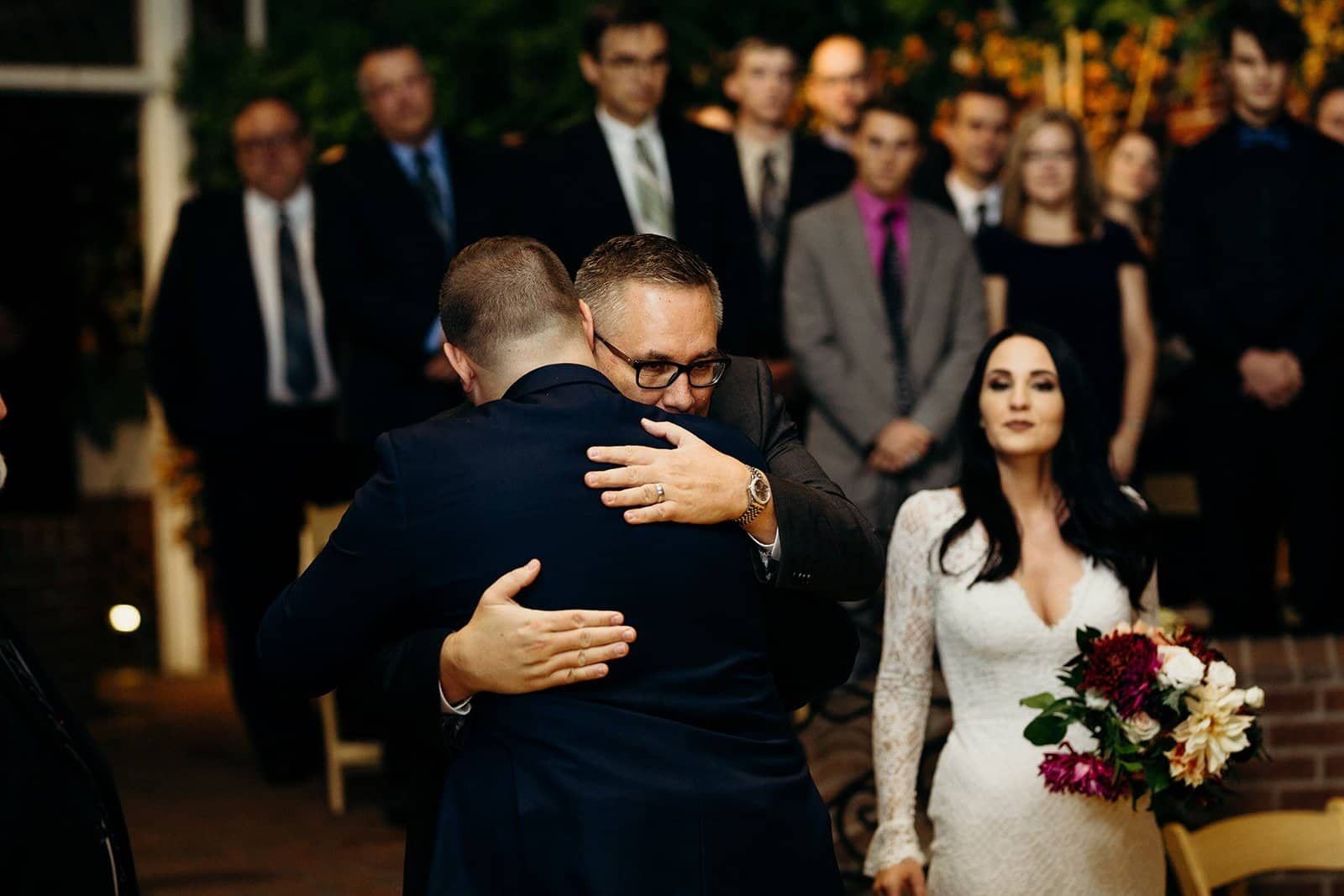 father of the bride hugs future son in law