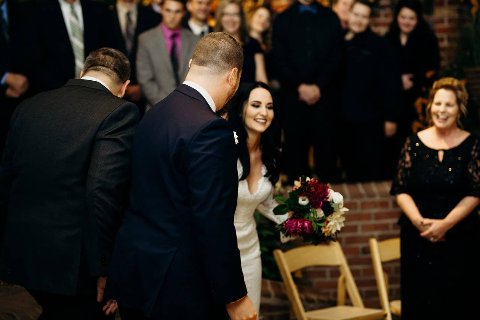 father of the bride gives daughter away