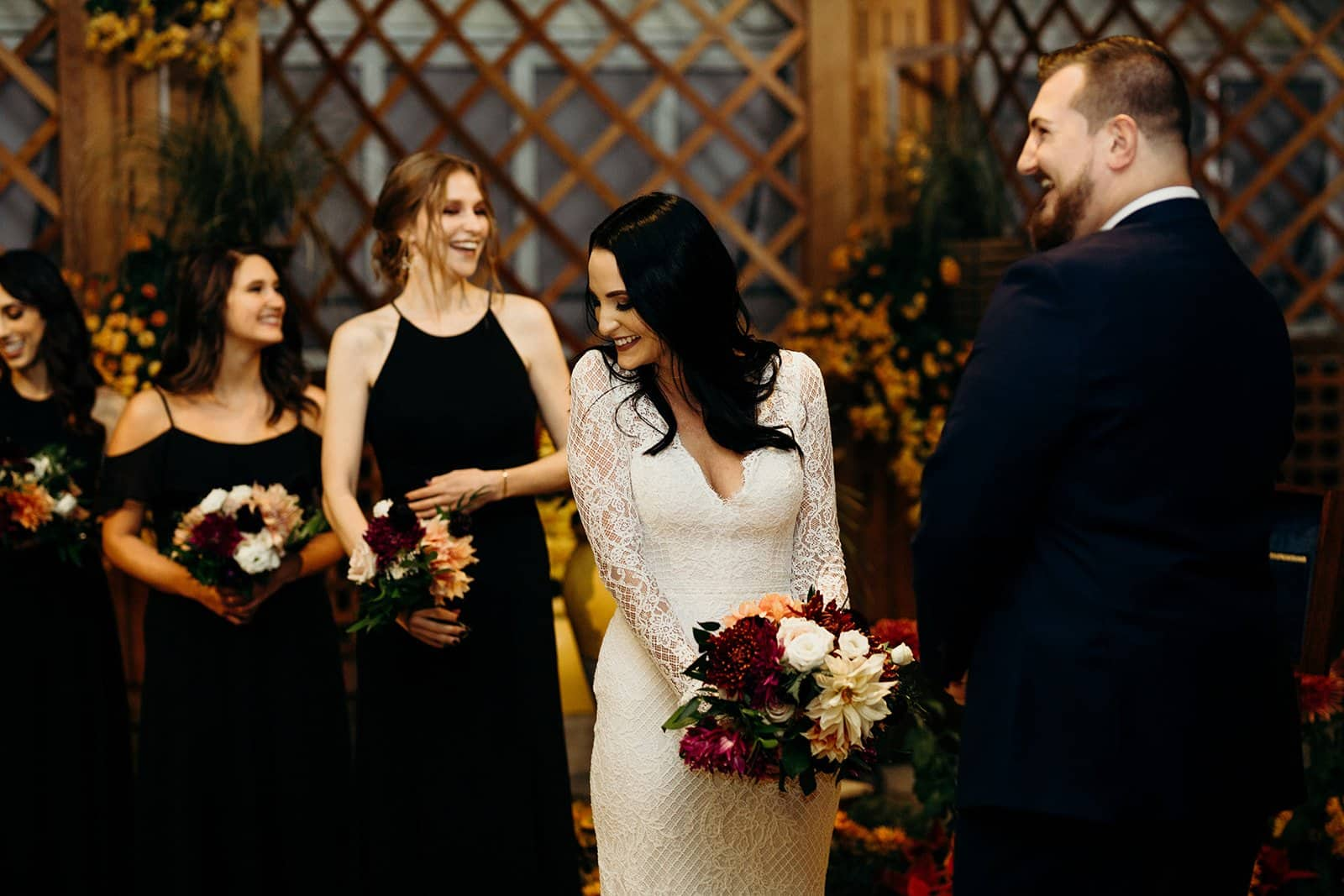 bride looks away from groom while laughing during ceremony