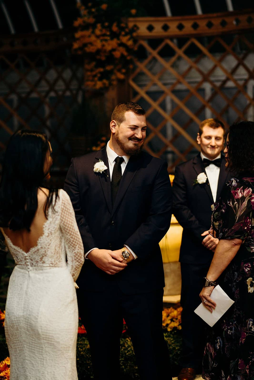 groom smiles at wedding guest