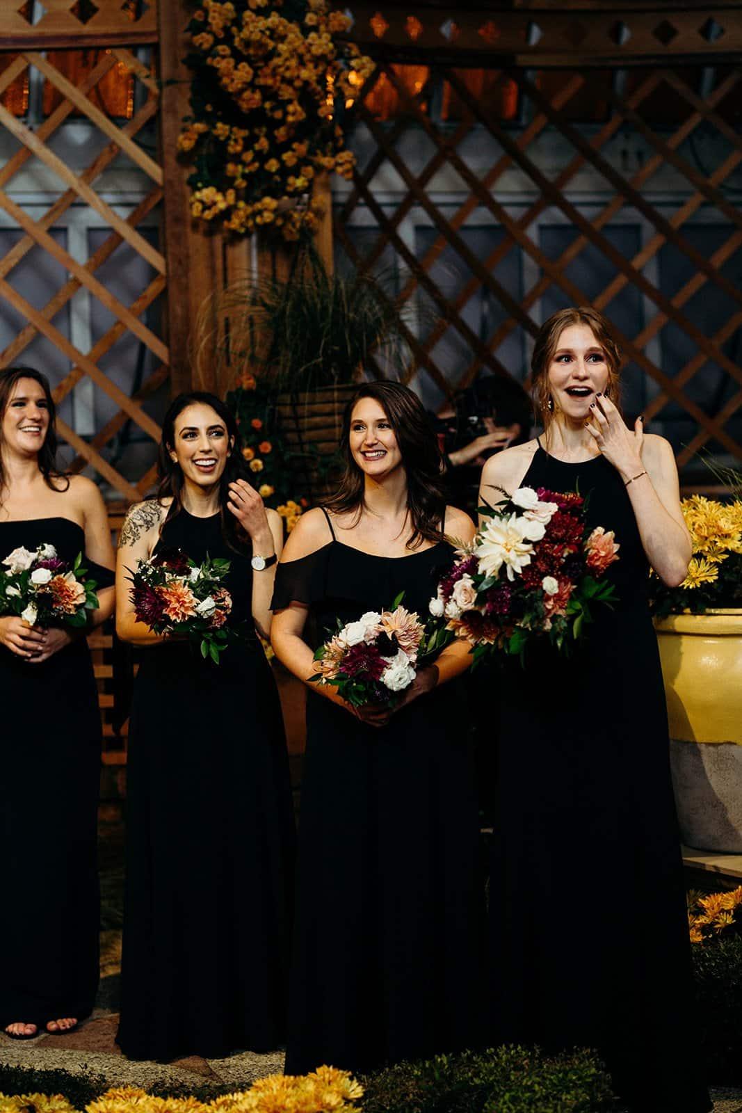 bridesmaids laugh during wedding ceremony