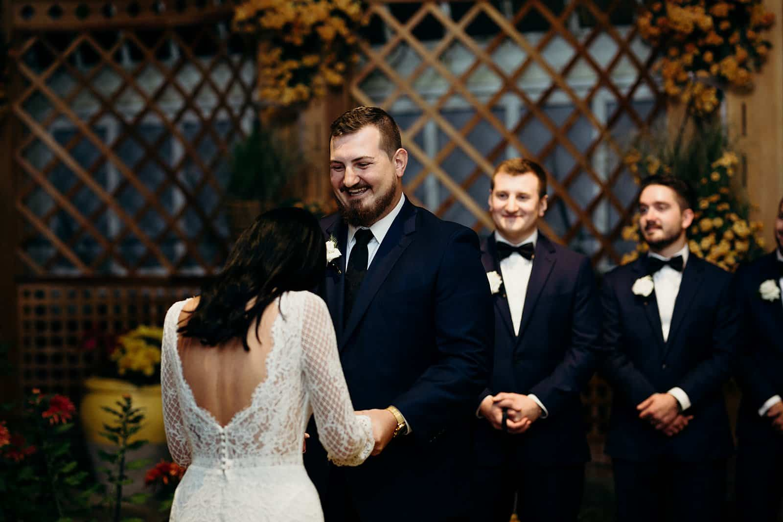 Husband laughs at bride during the ceremony