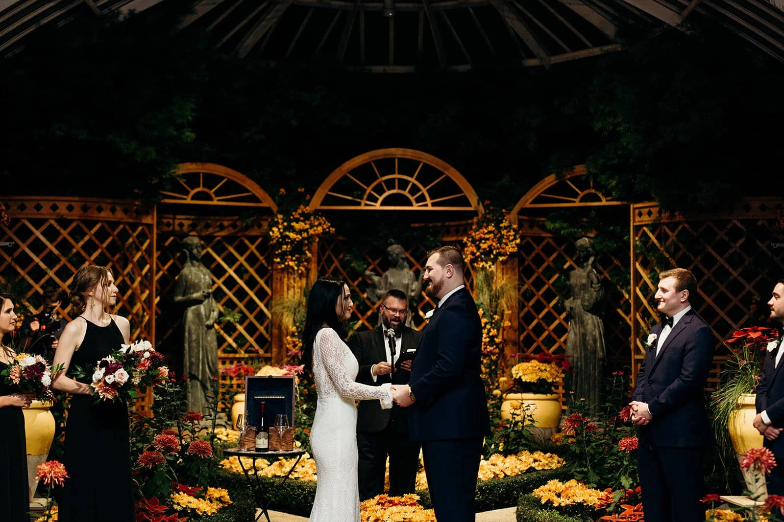husband and wife hold hands during a phipps conservatory wedding ceremony