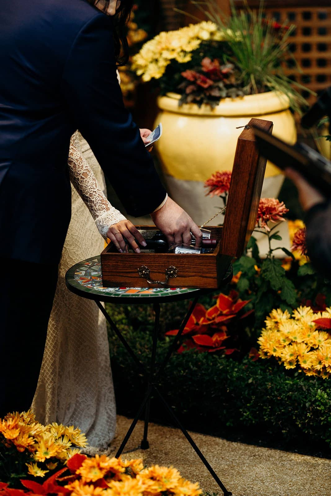 husband and wife place letters in memory box
