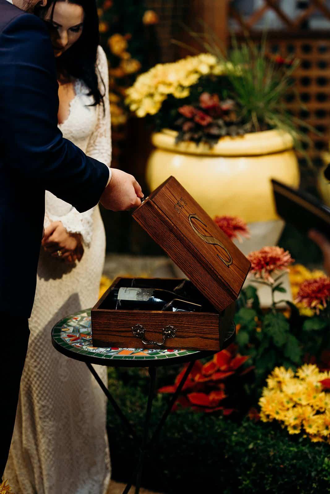 Groom closes wedding memory box