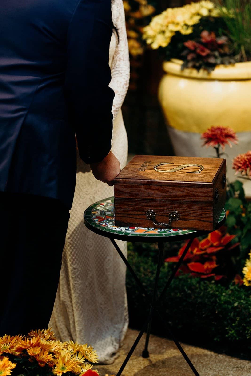 man locks wedding box