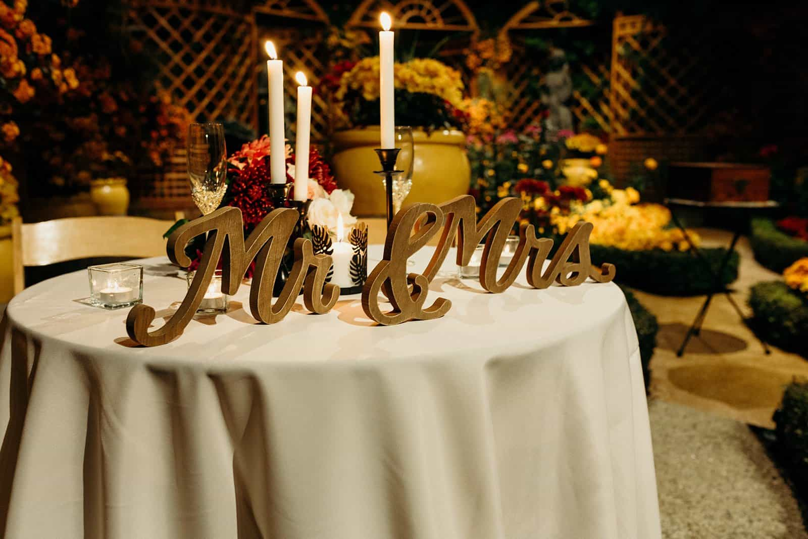Mr & Mrs sign with candles on table