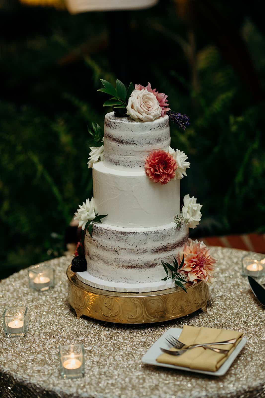 Wedding cake with flowers and candles