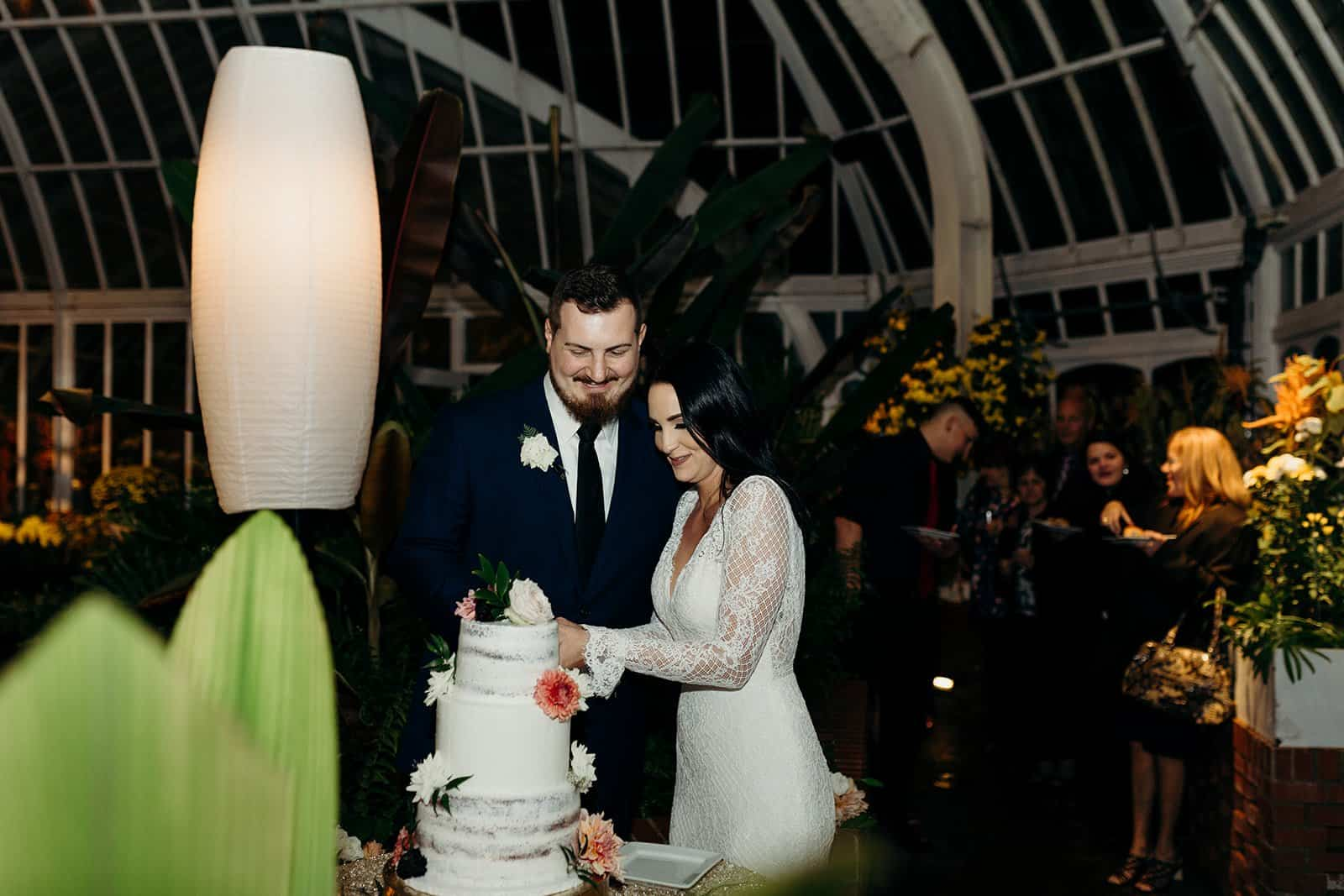 Cake cutting at a Phipps Conservatory wedding