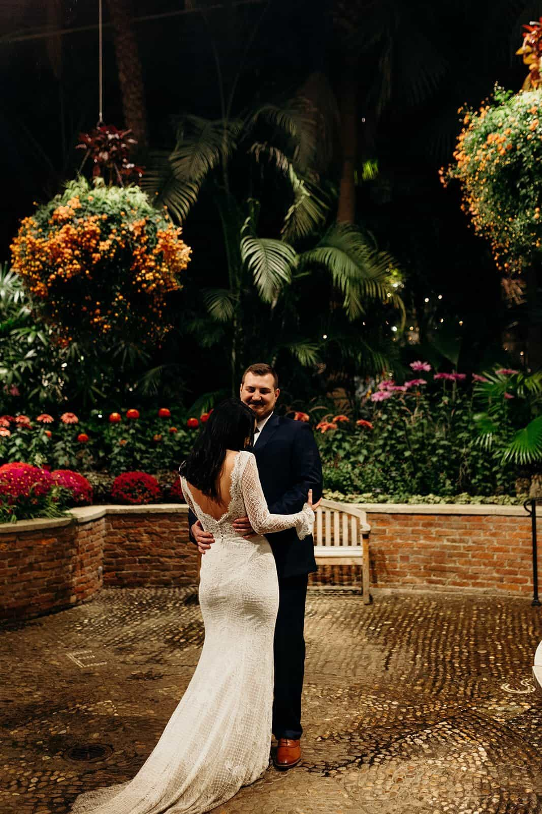 Bride and groom dance during a phipps conservatory wedding