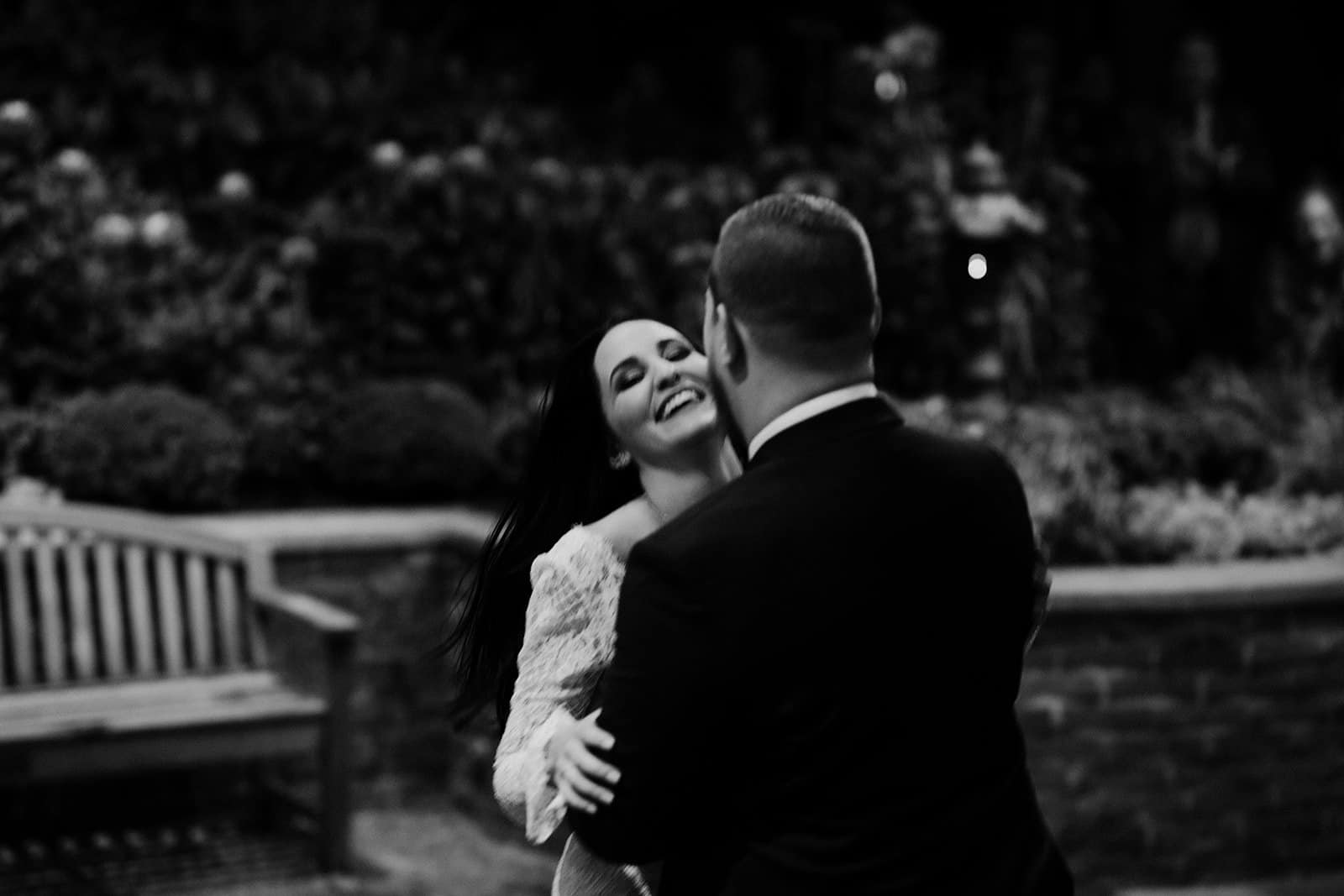 Bride smiles and laughs during first dance
