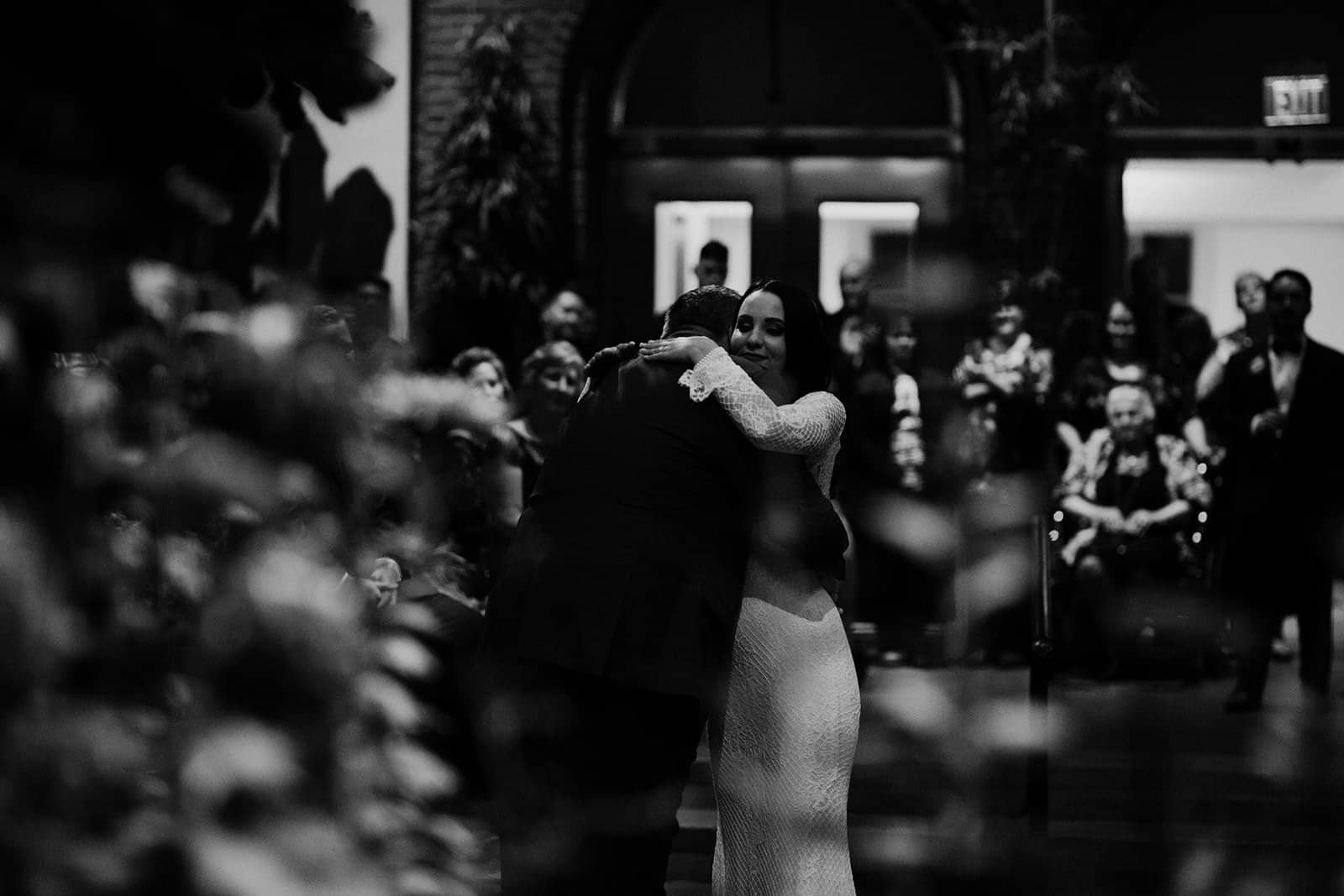 Bride and father hug after first dance