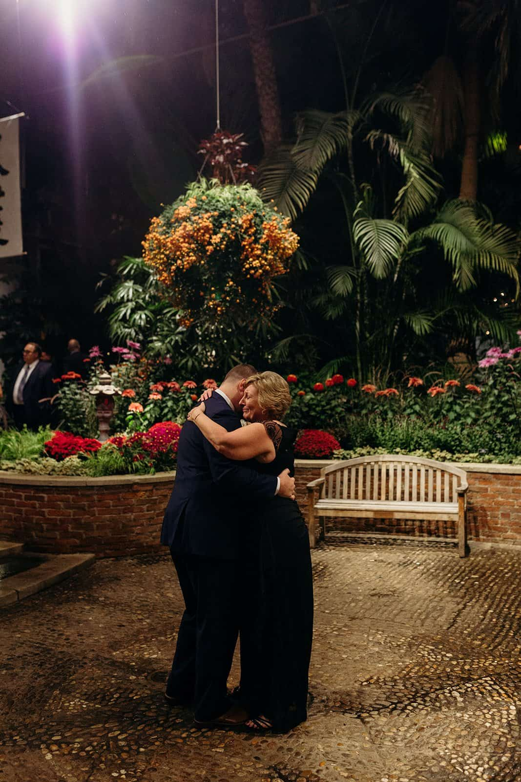 mother and groom embrace during first dances