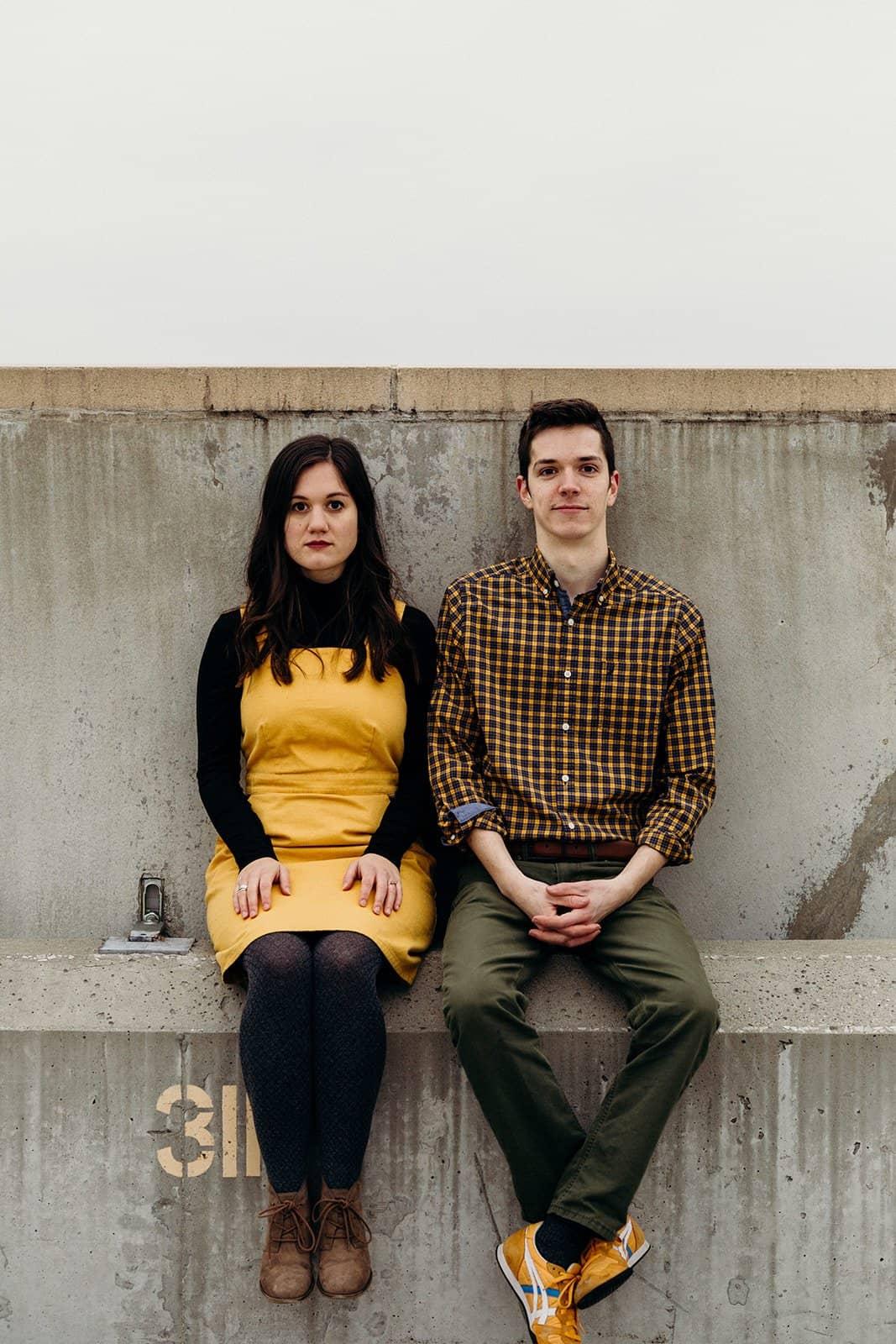 Kent Ohio Engaged couple posing on parking garage ledge