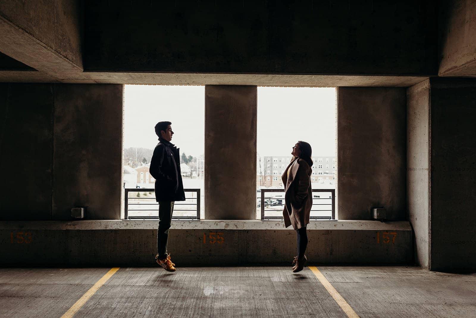 Kent Ohio Engaged couple jumping in parking garage