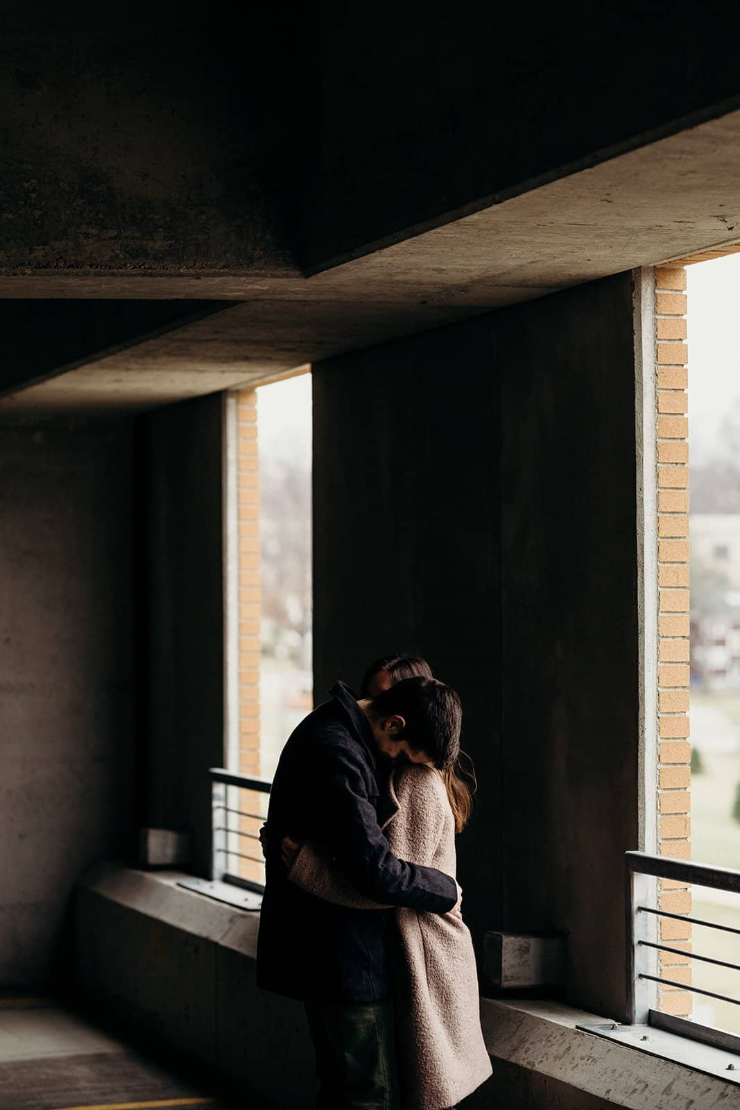 Kent Ohio Engagement couple posing near windows of parking garage