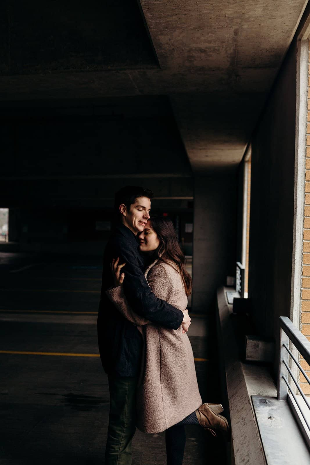 Kent Ohio engaged couple smile in parking garage