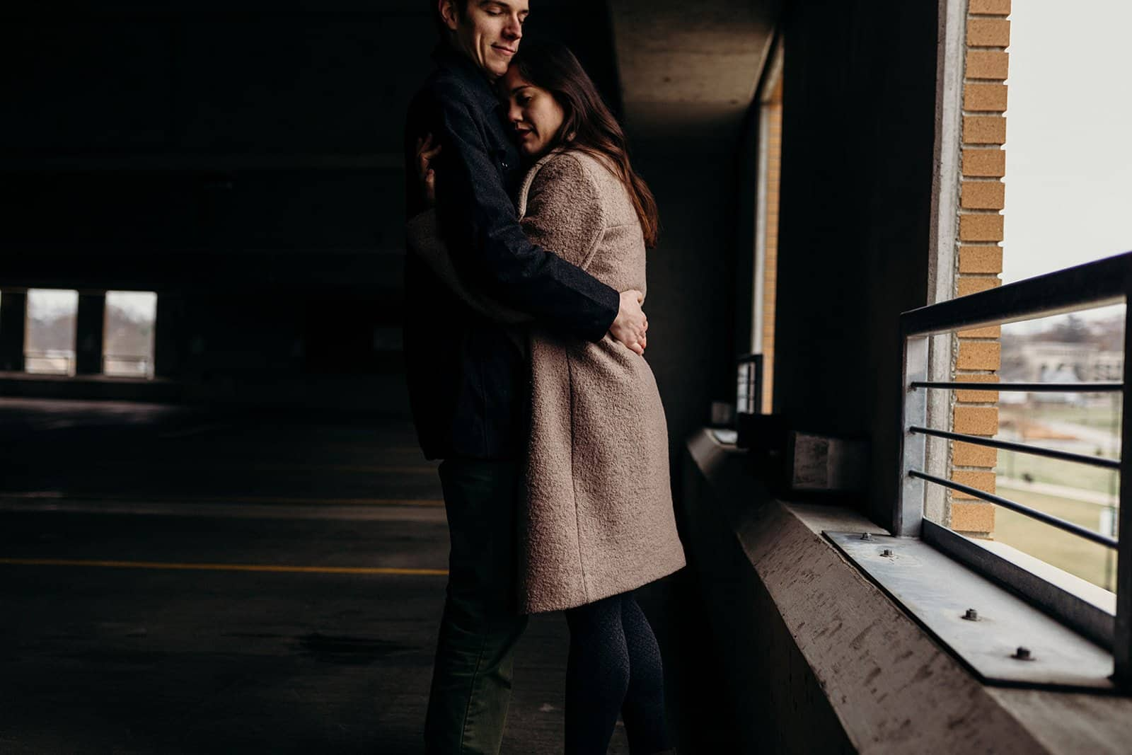 Kent Ohio engaged couple hug in parking garage