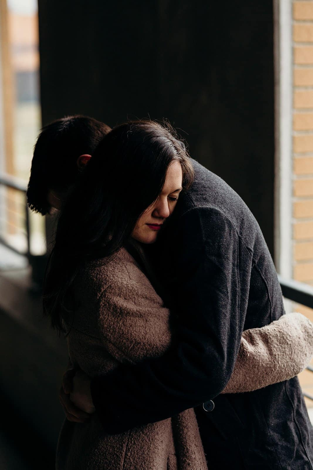Kent Ohio engaged couple hugs in parking garage