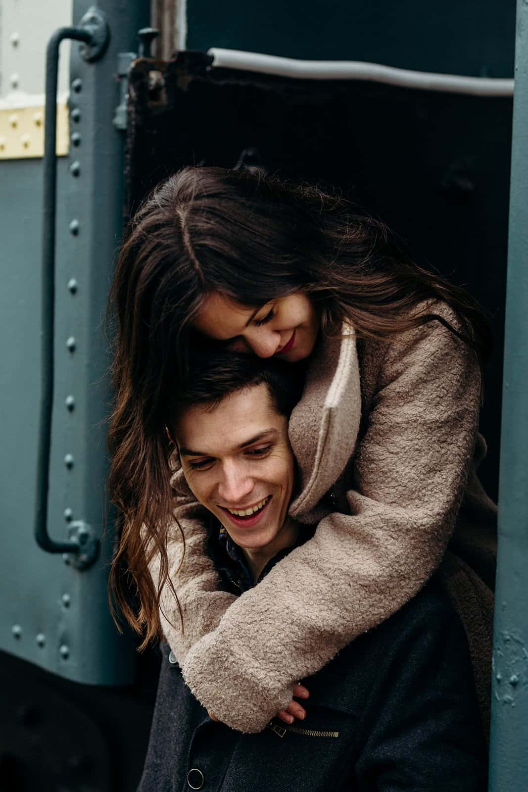 Man and woman cuddle on train in Kent Ohio