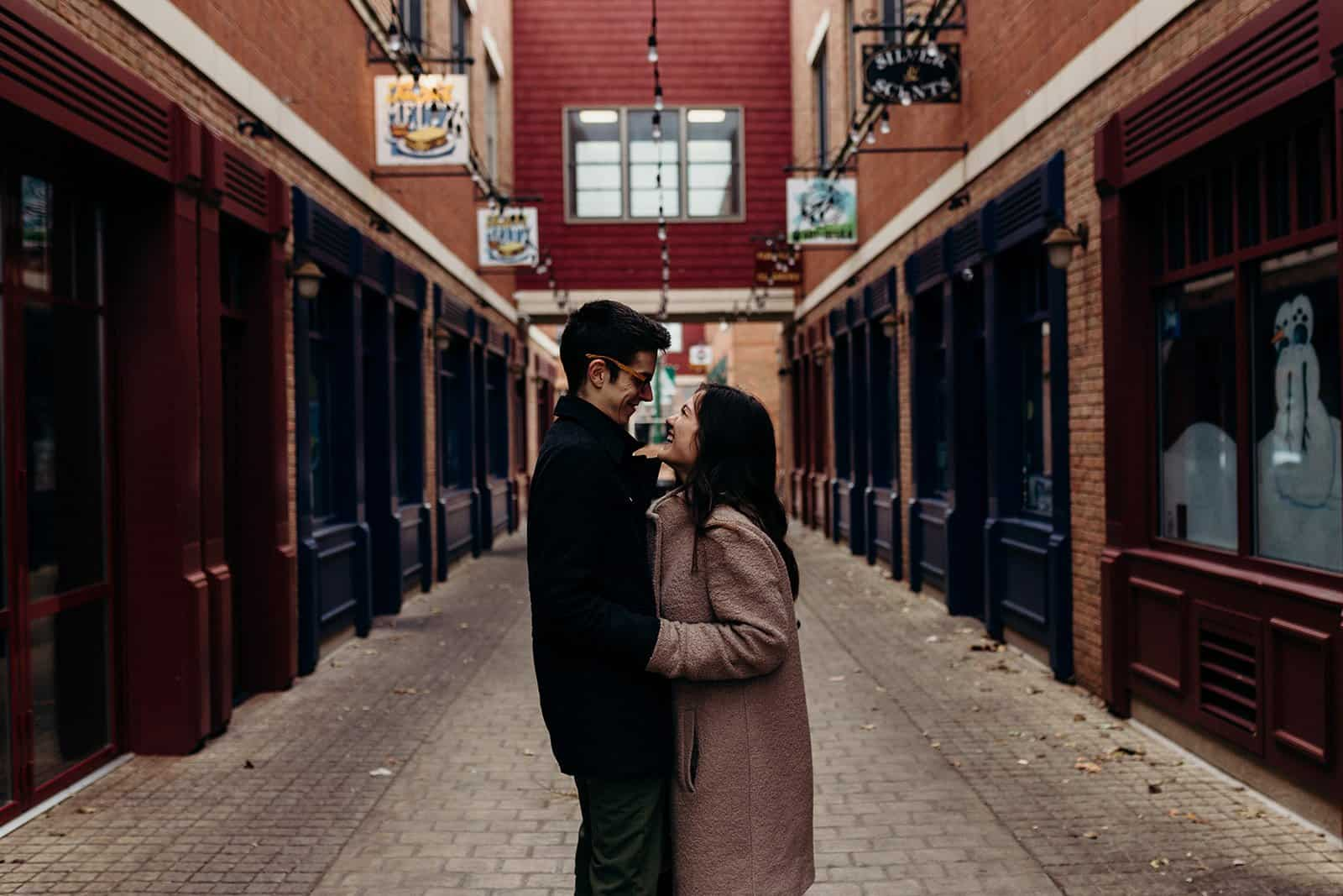 Kent ohio engaged couple laughing together in alley