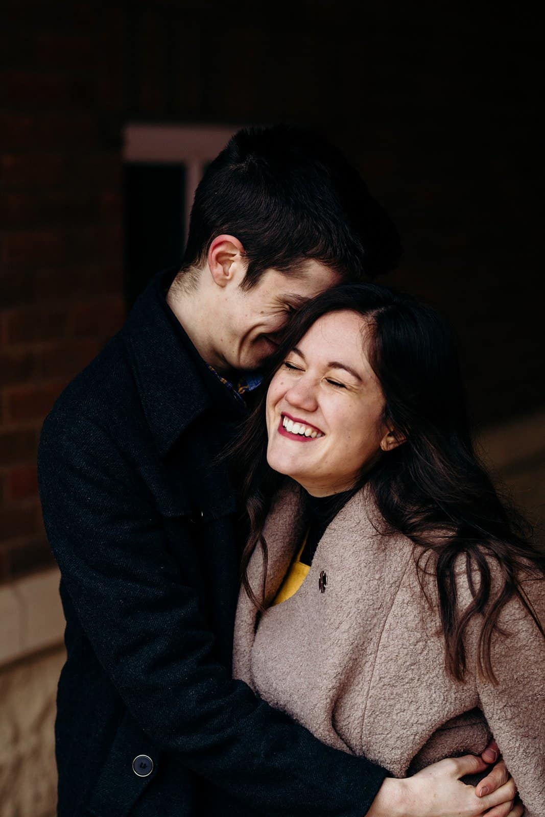 Kent ohio engaged couple laughing in doorway