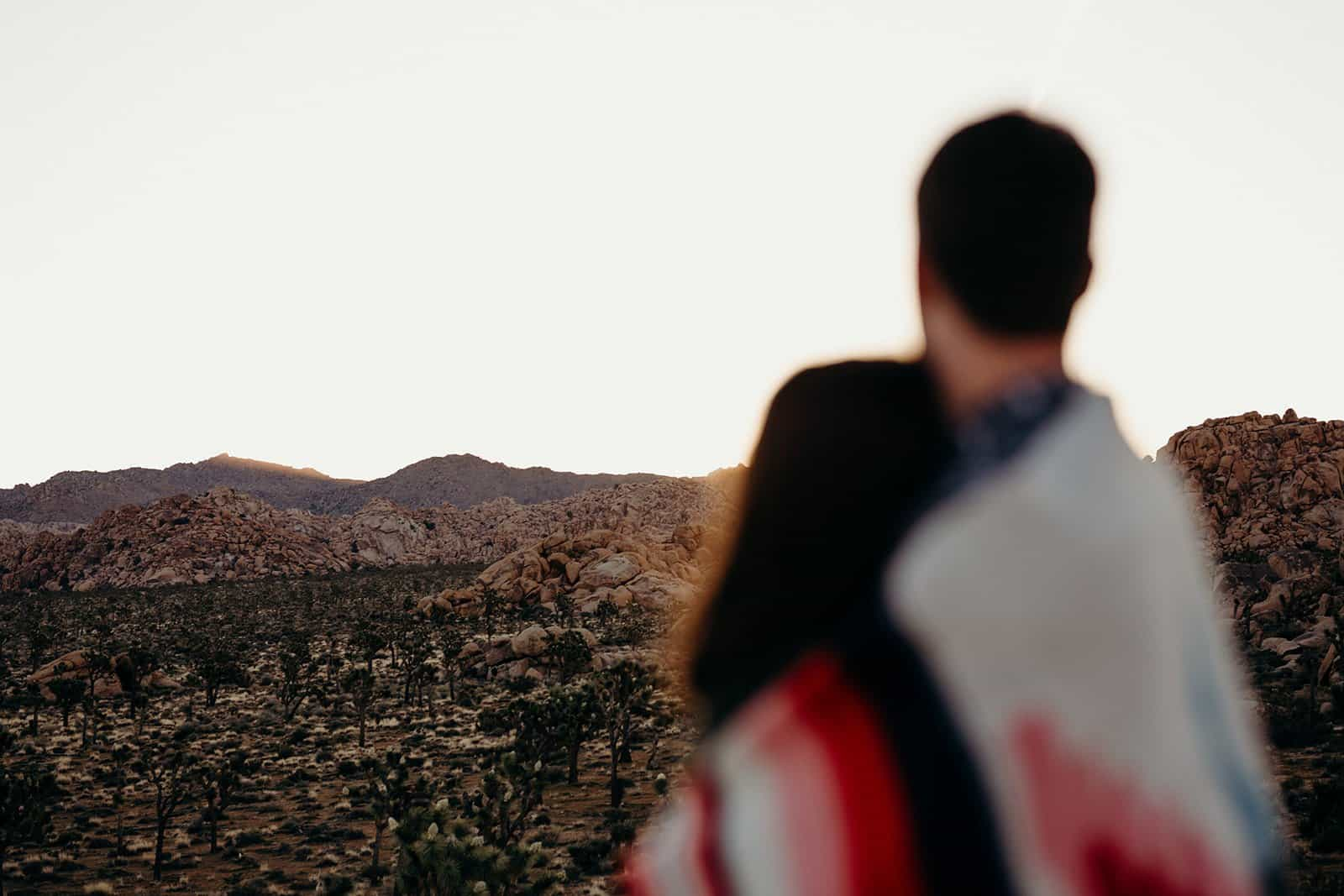 Couple watching Joshua Tree sunrise