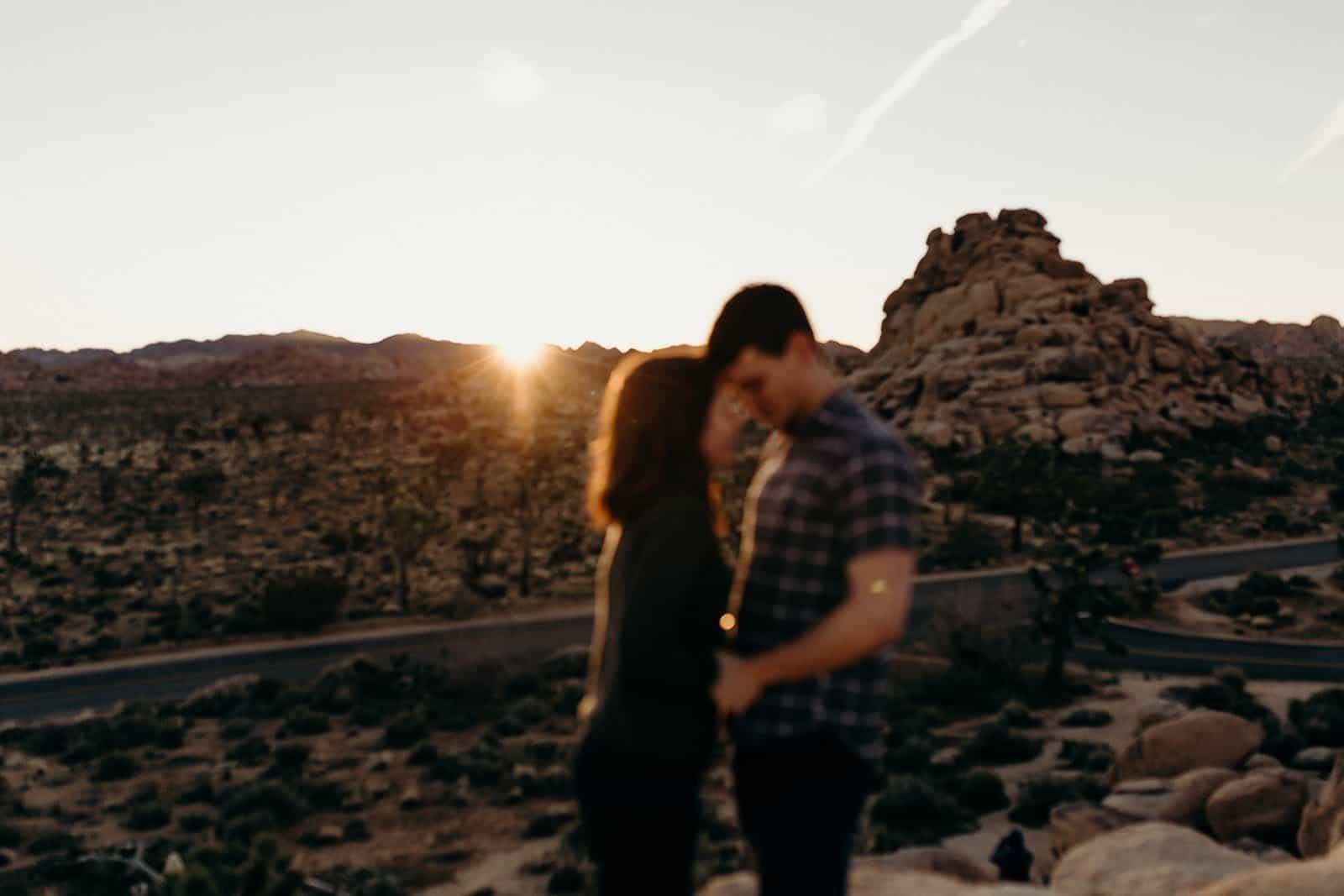 blurred sunrise photo of couple in Joshua Tree