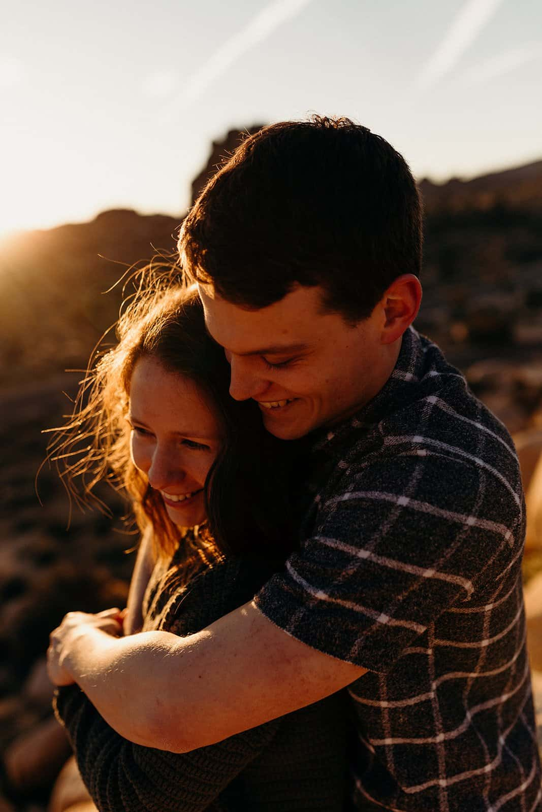 couple giggling and hugging in Joshua Tree sunrise