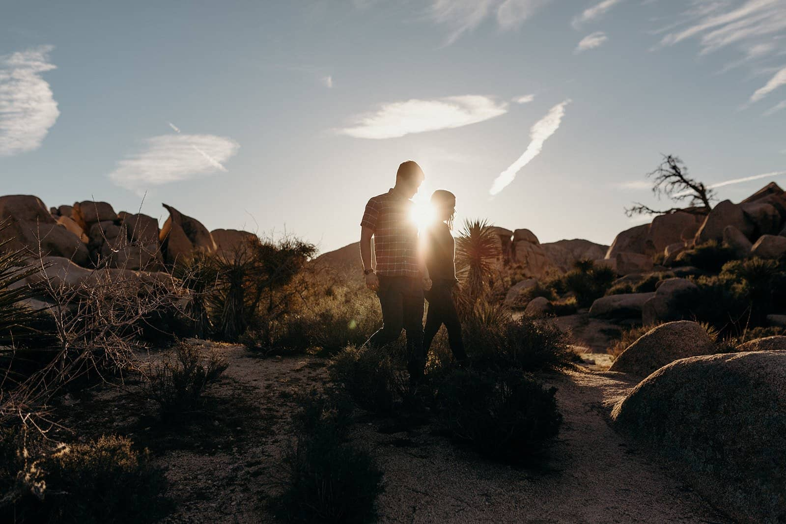 Couple walking through desert in Joshua Tree