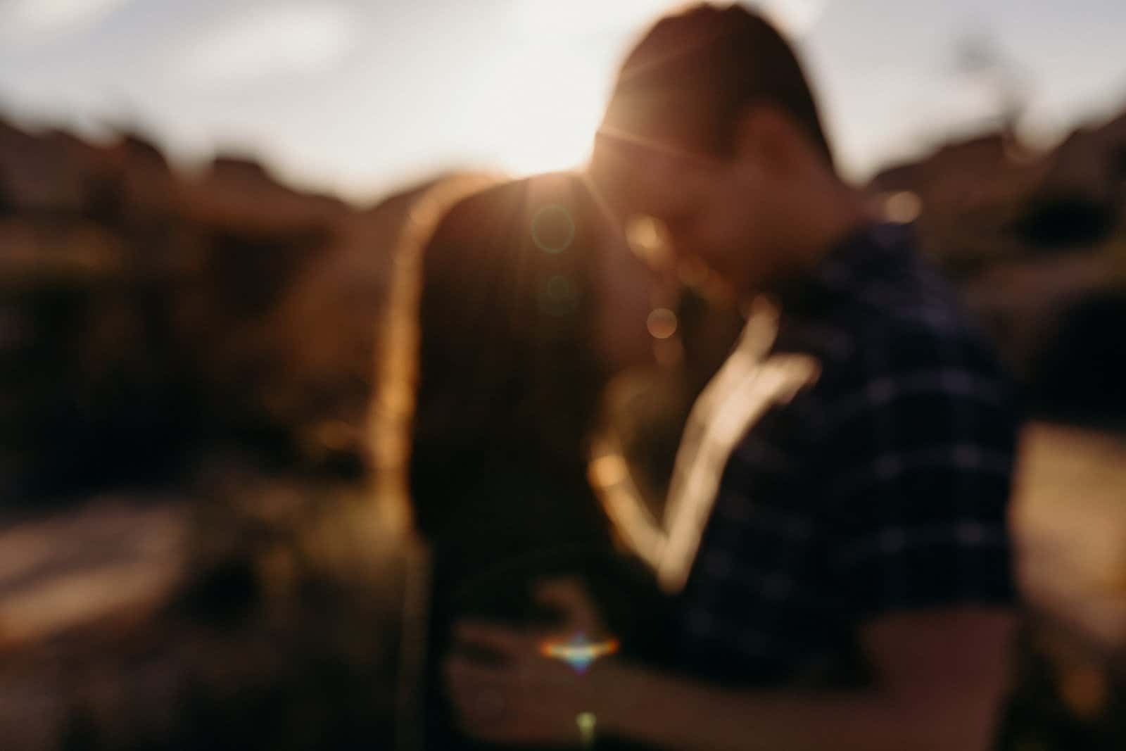 Blurred photo of couple embracing in Joshua Tree National Park