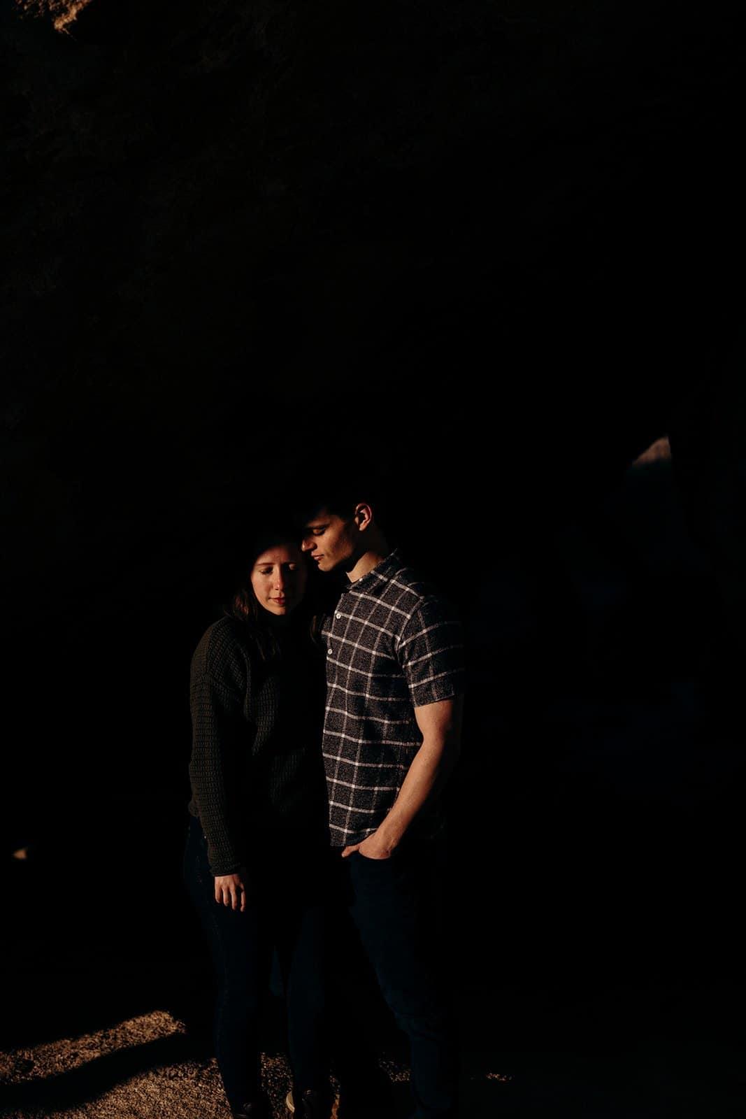 couple pose in desert on Joshua Tree trip