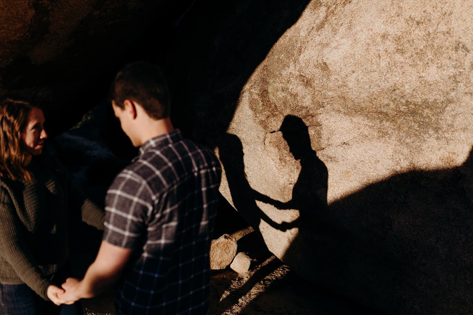 shadow of couple holding hands in Joshua Tree