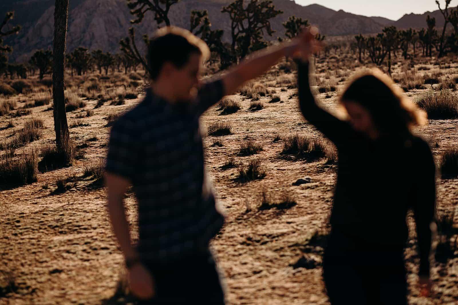Couple dancing in desert on Joshua Tree Trip